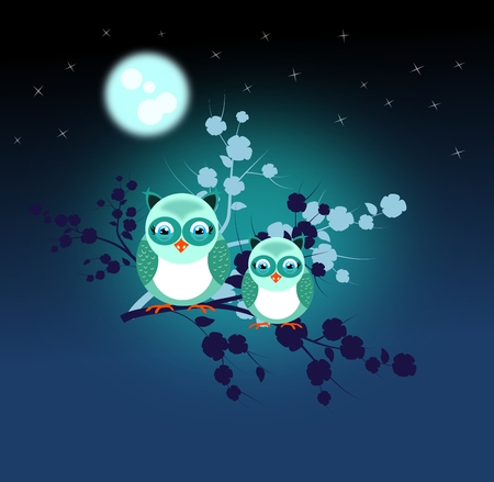 Two blue owls sitting on twig of tree in the night photo