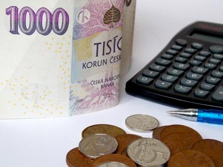 czech republic coin: Pile of czech money with calculator and ballpoint