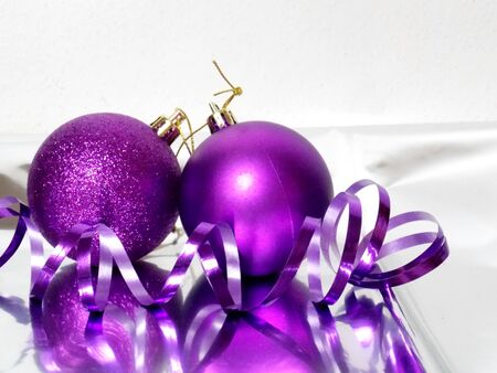 christmas bulbs: Photo of two purple christmas bulbs with ribbon decoration Stock Photo