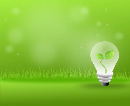grassy: Green grassy background with light bulb with leaves Stock Photo