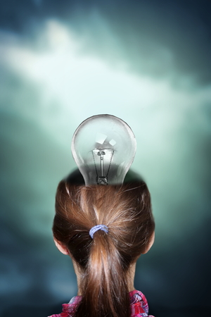 Photo manipulation of human head with light bulb