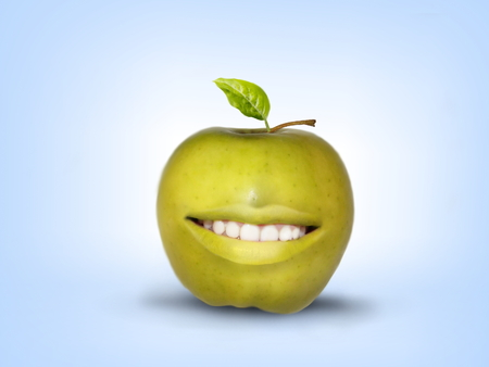 Photo manipulation of smiling green apple on light blue background Stock Photo