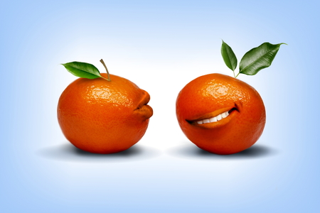 Photo manipulation of two tangerines with happy mood