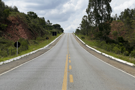 localization: Asphalt road with straight uphill Stock Photo
