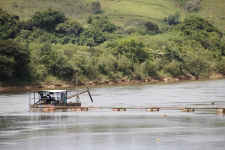dredge: Old dredge removing sand in river