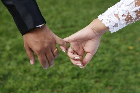Married hands with fingers showing wedding rings Stock Photo