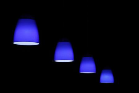 Blue circular lamp on black background