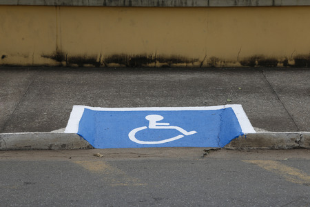 International symbol for wheelchair users designed on sidewalk