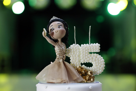 Party cake, 15 year anniversary, with doll holding cell phone