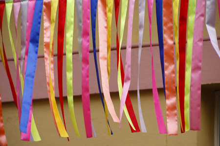 Colored ribbons - colored fabrics on cutouts - carnival decoration