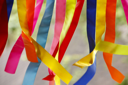 Colored ribbons - colored fabrics on cutouts - carnival decoration Imagens - 119216048