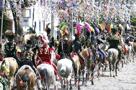 BONFIM, MG / BRAZIL - 2018-12-02: Carnival Parade in the State of Minas Gerais, city of Bonfim. Participants parade on horseback and wearing traditional costume - Carnival of Brazil - Carnaval a Cavalo.