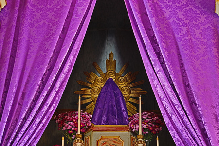 Holy Week - sacred images covered with purple cloth - altar of the holy week - catholic church
