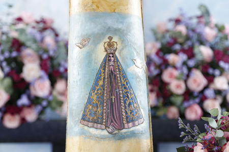 Statue of the image of Our Lady of Aparecida, mother of God in the Catholic religion, patroness of Brazil, image printed on tile