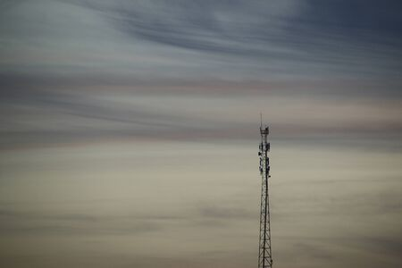 Telecommunications tower, telephone and internet antennas, afternoon as background, dusk and cell tower silhouette Фото со стока