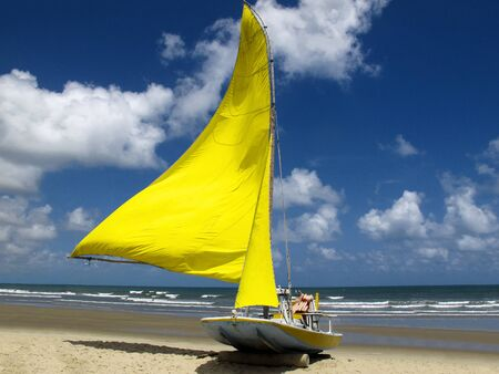 Sailing boat at genipabu beach in Extremoz, Natal, Rio Grande do Norte - Tourism and destinations in Northeast Brazil - Tourist attraction, travel guide for Brazil