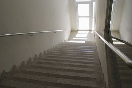 Stairway from top with clear door - concept of way forward - destination - direction to go Фото со стока