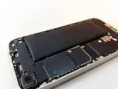 swollen mobile phone battery. phone Battery Replacement. old damaged battery smartphone.