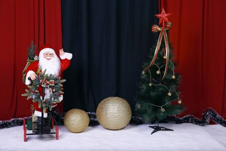 christmas and new year holidays background with Santa Claus, colorful ribbons and golden balls Imagens