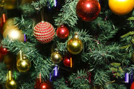 christmas and New Year holidays background with christmas balls, lights and tree - low exposure Imagens - 136053620