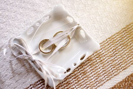 two gold wedding or engagement rings - couple golden rings - two wedding rings Imagens