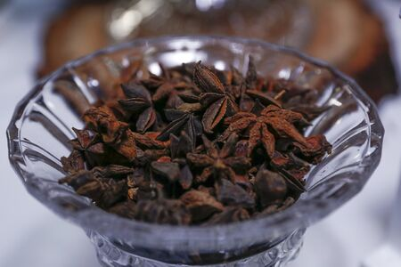 medicinal plant and spice star anise illicium verum in glass pot