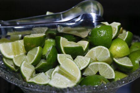 fruit green lemons sliced in glass jar