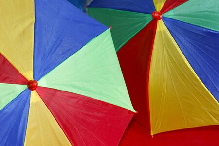 detail of two decorative and festive colorful carnival umbrellas Imagens