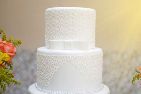 beautiful white party cake decorated with textures