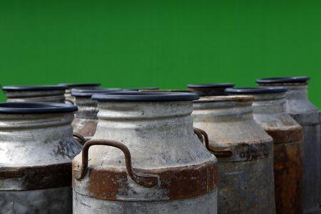 group of old metal cans for milk transport and handling Banco de Imagens