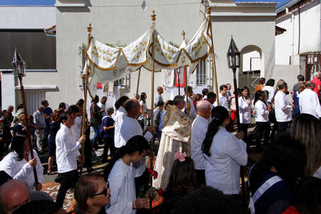 Minas Gerais / Brazil - June 20, 2019: faithful Catholic devotees participate in Corpus Christi procession