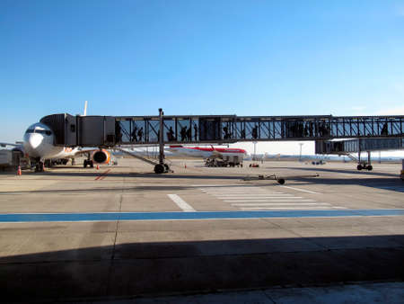 Confins, Minas Gerais / Brazil - July 28, 2018: Handling of passengers when boarding and disembarking at Confins - Tancredo Neves (CNF) international airport Editorial