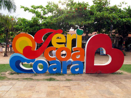Jericoacoara, CE / Brazil - January, 19, 2020 - arrival tourism signpost with Jericoacoara inscription in large, colorful letters in a square in the city or village Jericoacoara, state of Ceara Editorial