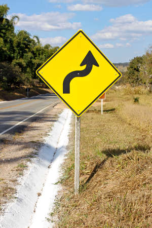warning traffic sign - sharp right curve - S curve Banco de Imagens