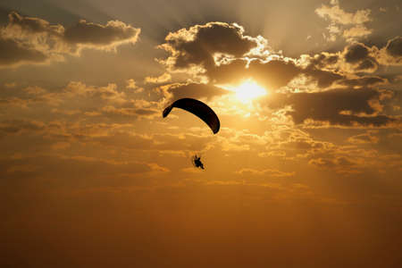 engine parachute flight towards sunset and late afternoon