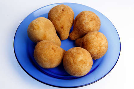 Small savory snacks, pear-shaped, deep-fried chicken filled croquette