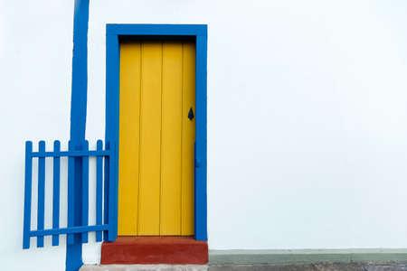 simple house facade with yellow door
