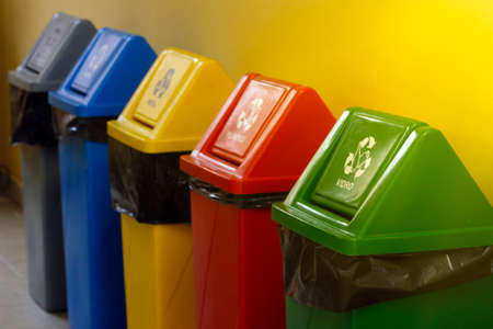 several plastic bins with different colors for garbage collection and separation