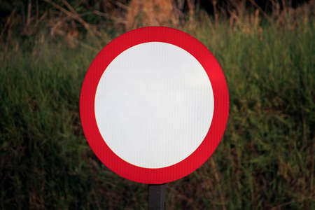 white and red traffic sign on road with no indication, blank, mockup Imagens