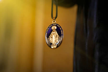closeup medal of our lady of graces, catholic religious devotional object