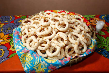 several homemade salted polvinho biscuits Torradinho, in basket and colorful party table Banco de Imagens