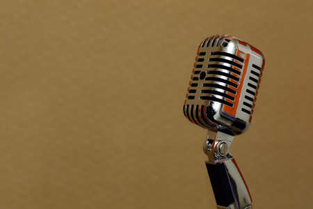 old metal microphone on stand and colorful studio set Banco de Imagens