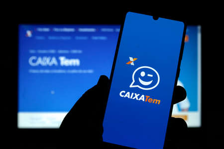 Minas Gerais, Brazil - March 21, 2021: client used the Caixa Tem application on a mobile phone Editorial