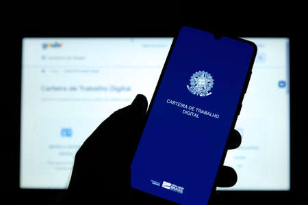 Minas Gerais, Brazil - March 21, 2021: client used the Work and Social Security Card (CTPS) application on a mobile phone - digital work card Editorial