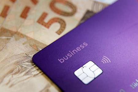 Minas Gerais, Brazil - March 25, 2021: Nubank Business credit card detail. Digital payment system - selective focus