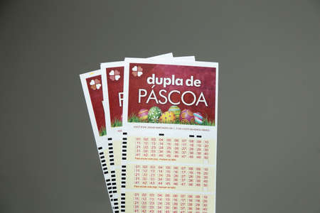 Minas Gerais, Brazil - April 6, 2021: Lottery ticket Caixa Duplo Sena de Pascoa Editorial