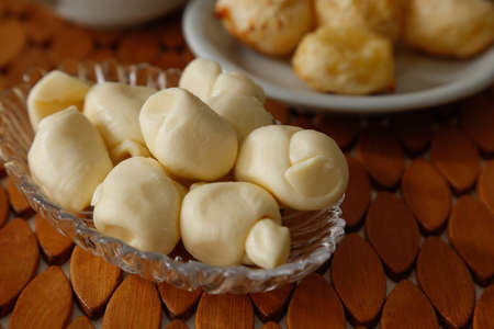cheese nozinho type, several units, on a coffee table - portion of knots