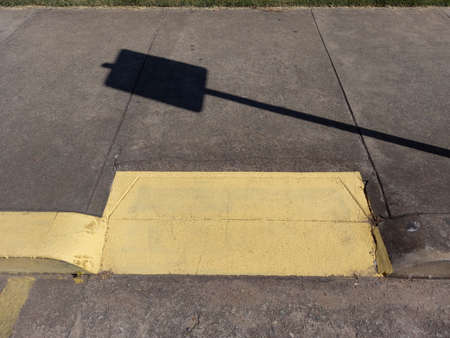 accessibility ramp for wheelchair users with yellow color on a public road