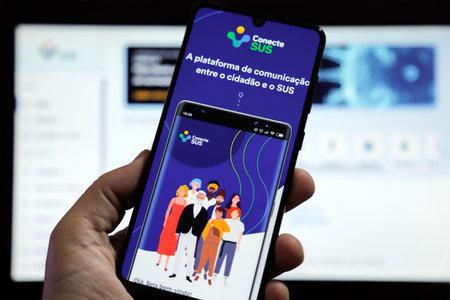 Minas Gerais, Brazil - April 21, 2021: client used the Conecte SUS application on a mobile phone