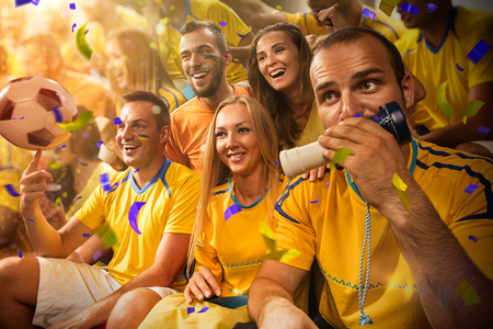cheering people: Fun soccer Fans in stadium arena Confetti and tinsel